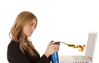 woman torching laptop