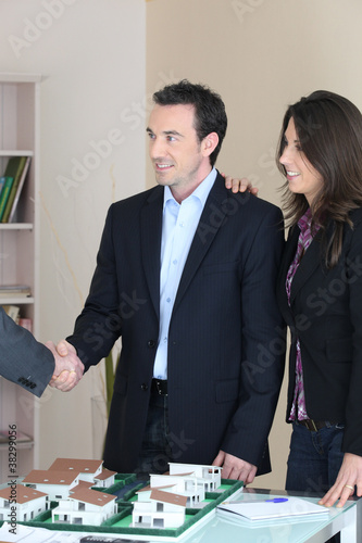 Couple discussing a housing development