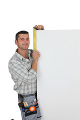 Manual worker stood with blank panel