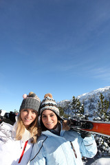 friends at ski resort against deep blue sky
