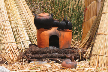 Traditional Uros people earthen cooker, Titicaca, Peru