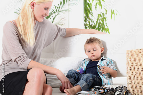 Woman sitting with a little boy