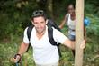 happy couple on a mountain hike