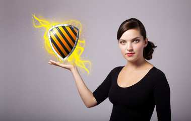 woman holding virtual shield sign