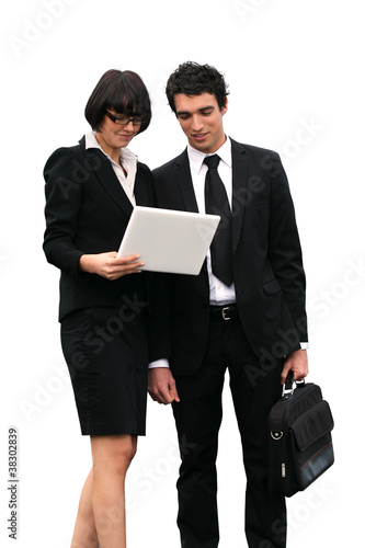 Business partners reading important document