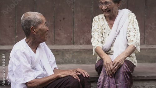 Two old asian women talking and laughing