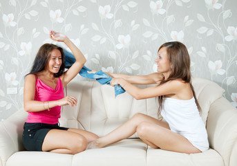 Happy women fighting with clothes