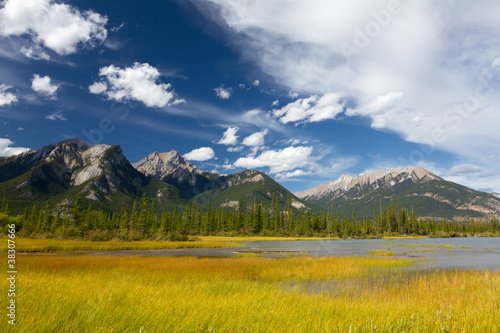 Swampy Lake, Rocky Mountains and Cloudy Sky
