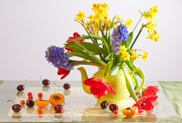 Bunch of flowers in a teapot