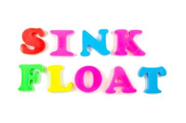 sink and float written in fridge magnets