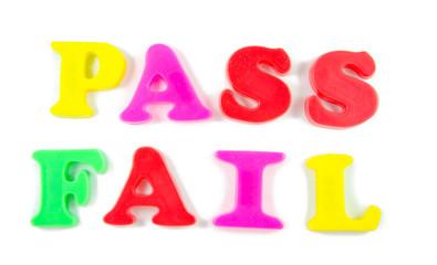 pass and fail written in fridge magnets