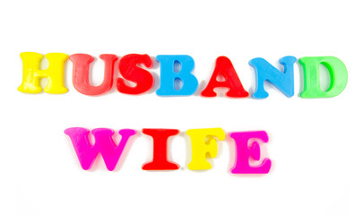 husband and wife written in fridge magnets
