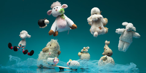 funny group toy sheeps playing different games