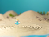 little toy angel in miniature landscape