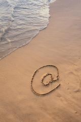Email symbol draw on beach