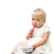 Portrait of blue eye baby girl with red spoon