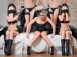 some girls sit on the bed in black lingerie