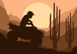 All terrain vehicle quad motorbike rider in wild nature desert