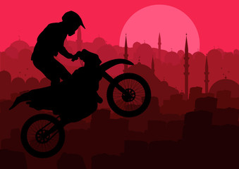 Motorbike rider in Arabic city landscape background