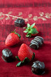 Strawberries and Chocolates on Red Background