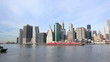 Lower Manhattan skyline and cargo ship in New York