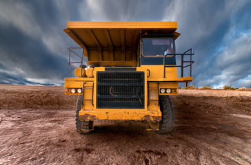 Huge auto-dump yellow mining truck