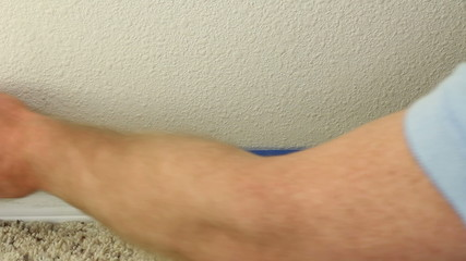 Applying Blue Painter's Tape to Prepare for Painting