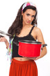 Beautiful young woman holding cooking pot