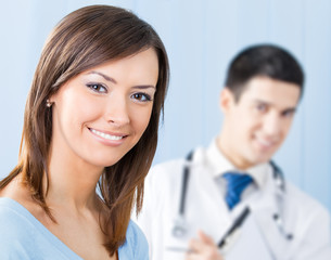 Smiling patient and doctor at office