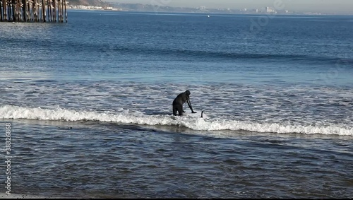 eighty year old man surfing in Malibu