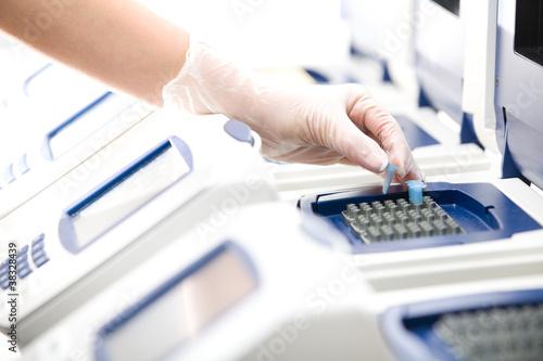 Scientist, DNA copy, white gloves, distant shot
