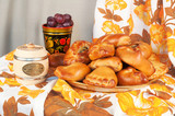 Still Life in the Russian style with pastries and other foods