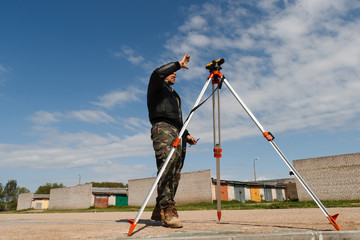 Land surveyor on construction site