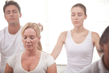 Group of people meditating at the yoga center