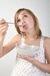 child eating milk porridge