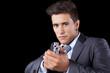 Businessman aiming a handgun