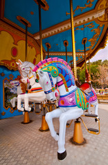 Colorful horses in the carousel