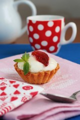 Strawberry tart with cream and coffee