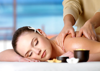 Spa massage for shoulder of woman