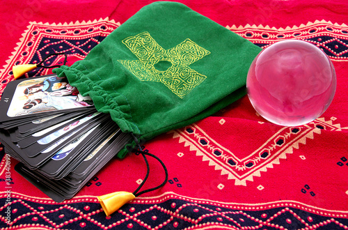 Tarot cards in green pouch  and crystal ball
