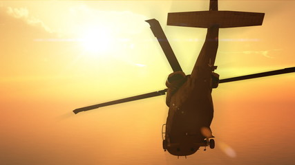 Helicopter flying in the sunset