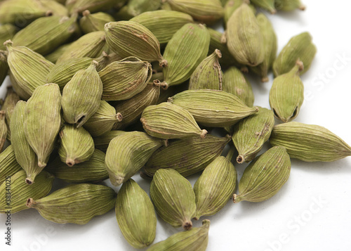 Cardamon seeds isolated on white