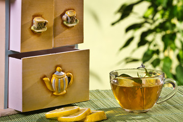 Tea cupboard and hot tea and lemon