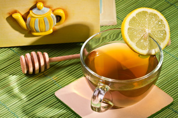 Cup of tea and Cupboard with honey dipper