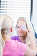 optometry concept - pretty, young female patient