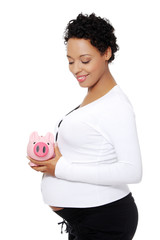 Pregnant woman with a piggybank.