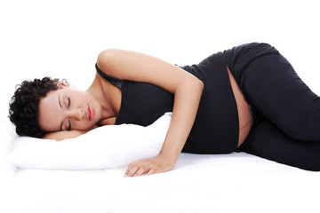 Pregnant woman while sleeping.