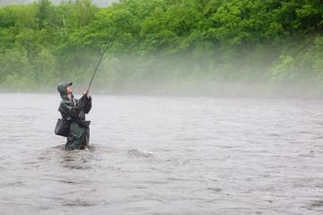 Fisherman caught a salmon river