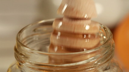 Breakfast - Honey dripping on glass container
