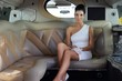 Elegant woman sitting in luxury limousine